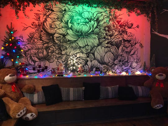 Walden's Christmas pop-up is replete with dancing Santas and a fireplace lounge.