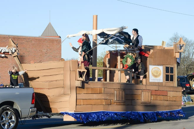 Actors Point and Green Village Recyling's float made of recycled cardboard won an award from the 2018 US Pest Holidayfest Hendersonville Christmas Parade.