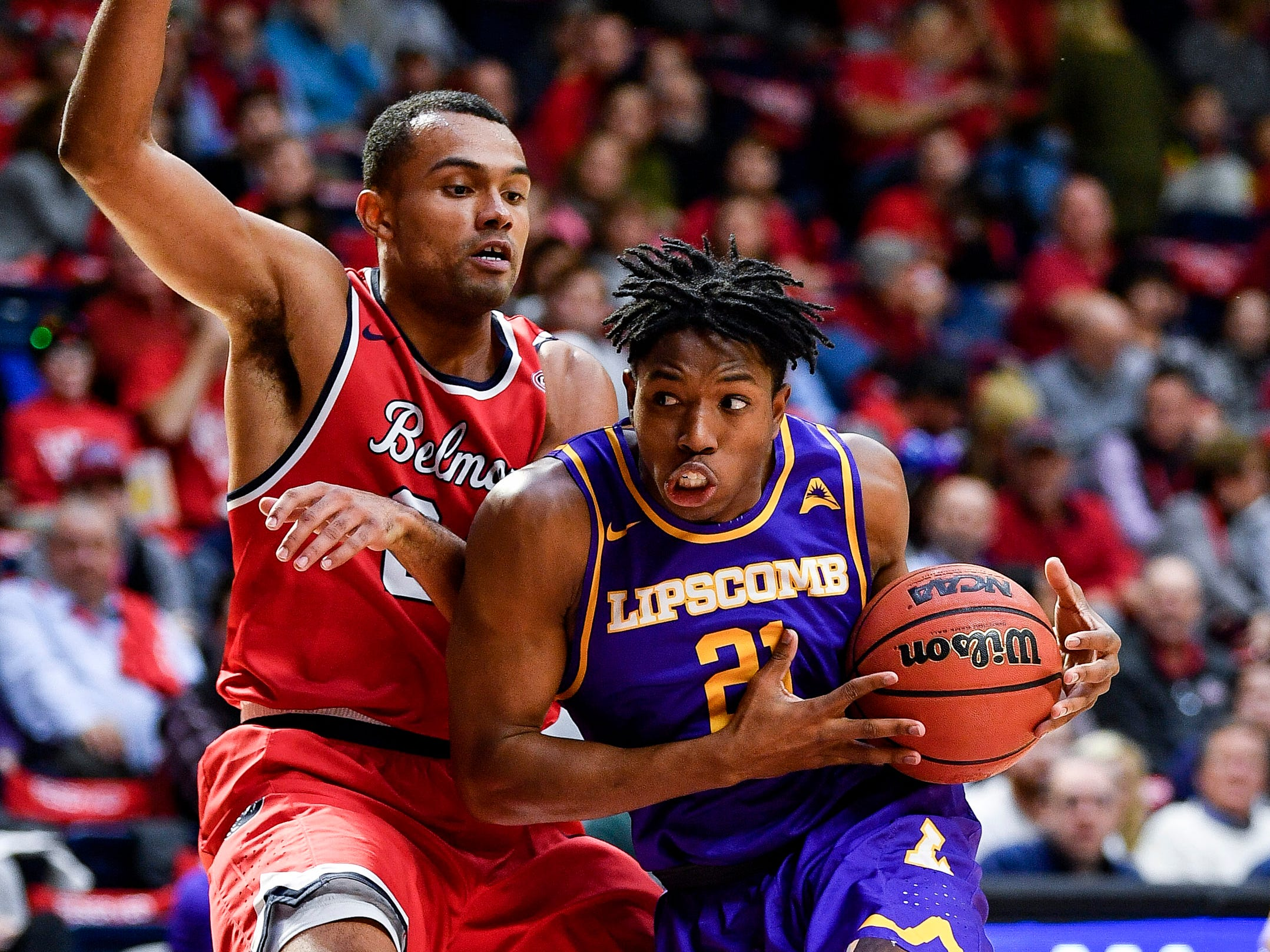 Belmont guard Michael Benkert (24) guards Lipscomb guard Kenny Cooper (21) during the second half at the Curb Event Center in Nashville, Tenn., Tuesday, Dec. 4, 2018.