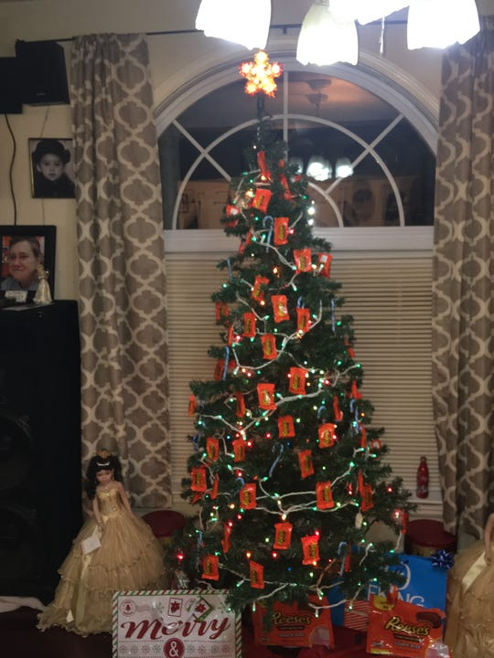 Lavoy Sales, a self-proclaimed Reese's Peanut Butter Cup superfan, even decorated his Christmas tree with Reese's cups this year. He owns a decorated car that caught the candymaker's attention.