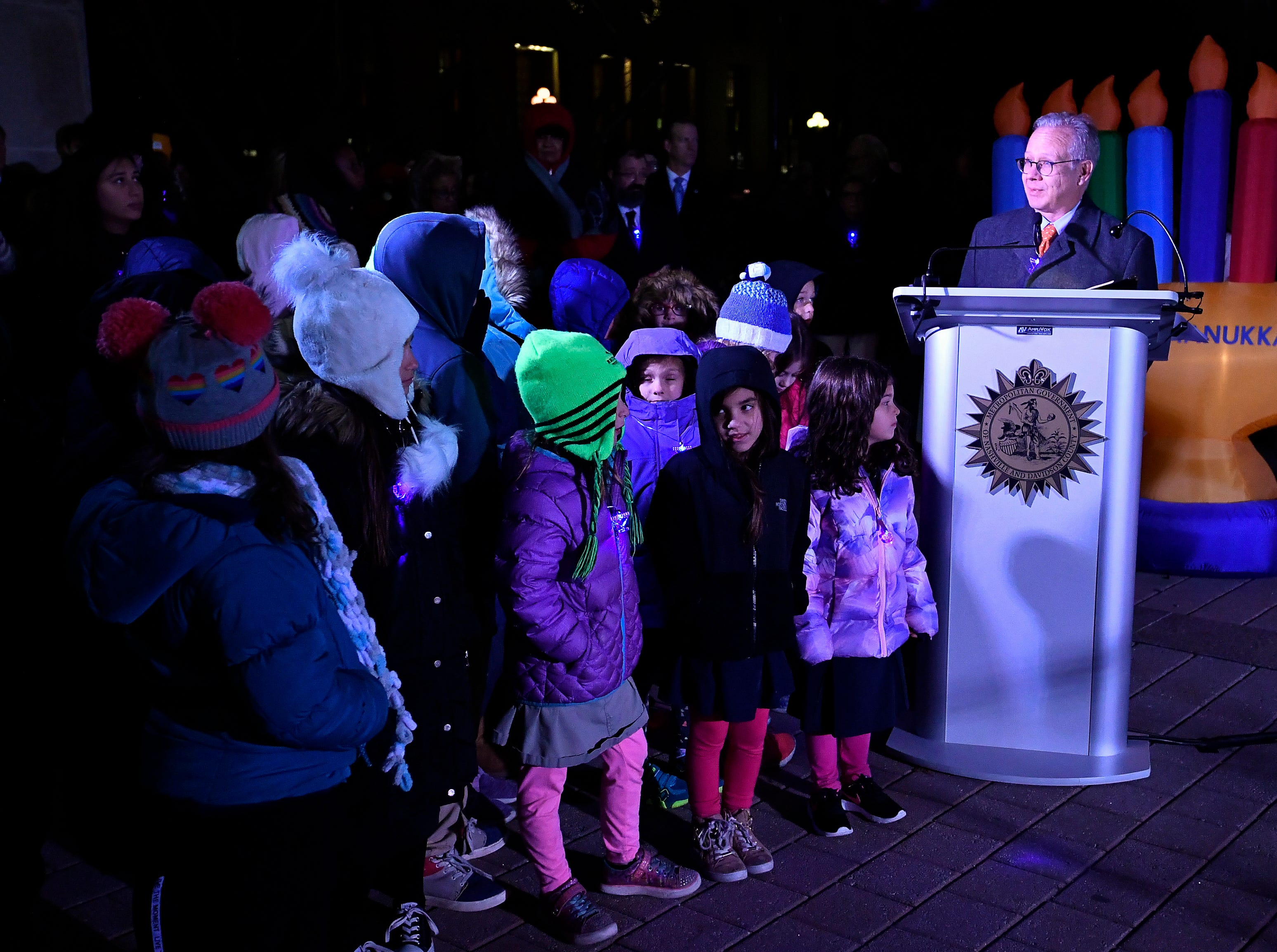Mayor David Briley addresses the crowd during a Chanukah menorah lighting ceremony at Public Square Park Tuesday, Dec. 4, 2018, in Nashville, Tenn.