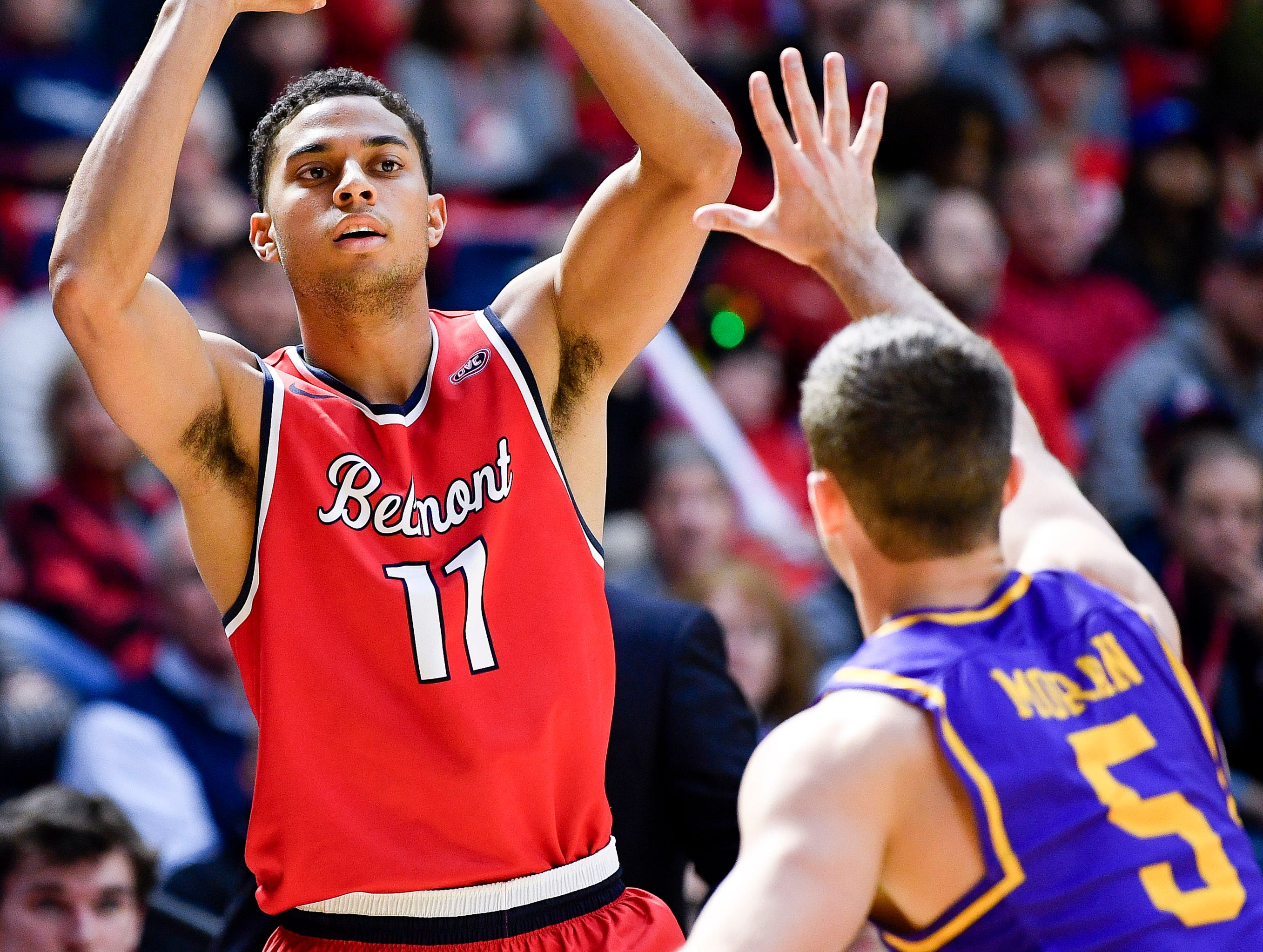 Belmont guard Kevin McClain (11) looks to pass past Lipscomb guard Nathan Moran (5) during the first half at the Curb Event Center in Nashville, Tenn., Tuesday, Dec. 4, 2018.