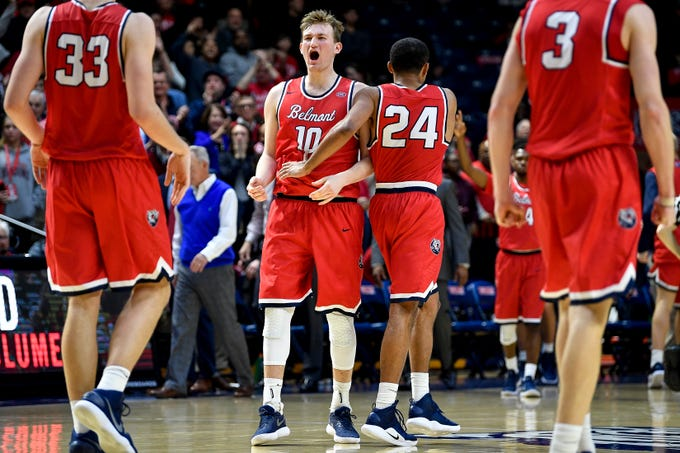Belmont forward Caleb Hollander (10) and guard Michael Benkert (24) celebrate defeating Lipscomb at the Curb Event Center in Nashville, Tenn., Tuesday, Dec. 4, 2018.