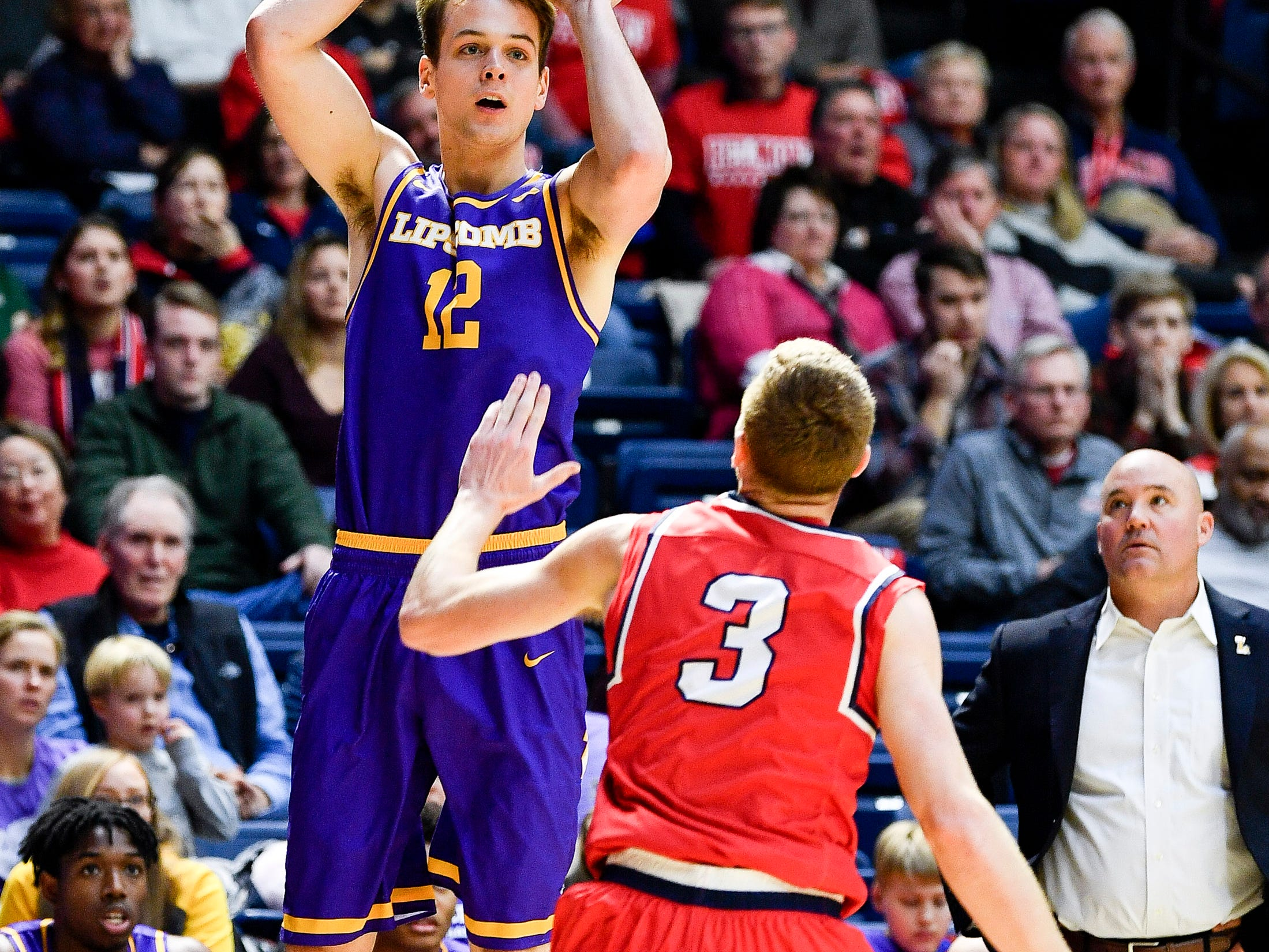 Lipscomb forward Matt Rose (12) shoots over Belmont guard/forward Dylan Windler (3) during the second half at the Curb Event Center in Nashville, Tenn., Tuesday, Dec. 4, 2018.