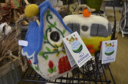 Black Tie Floral sells fair trade items, such as these felt birdhouses made in Nepal.