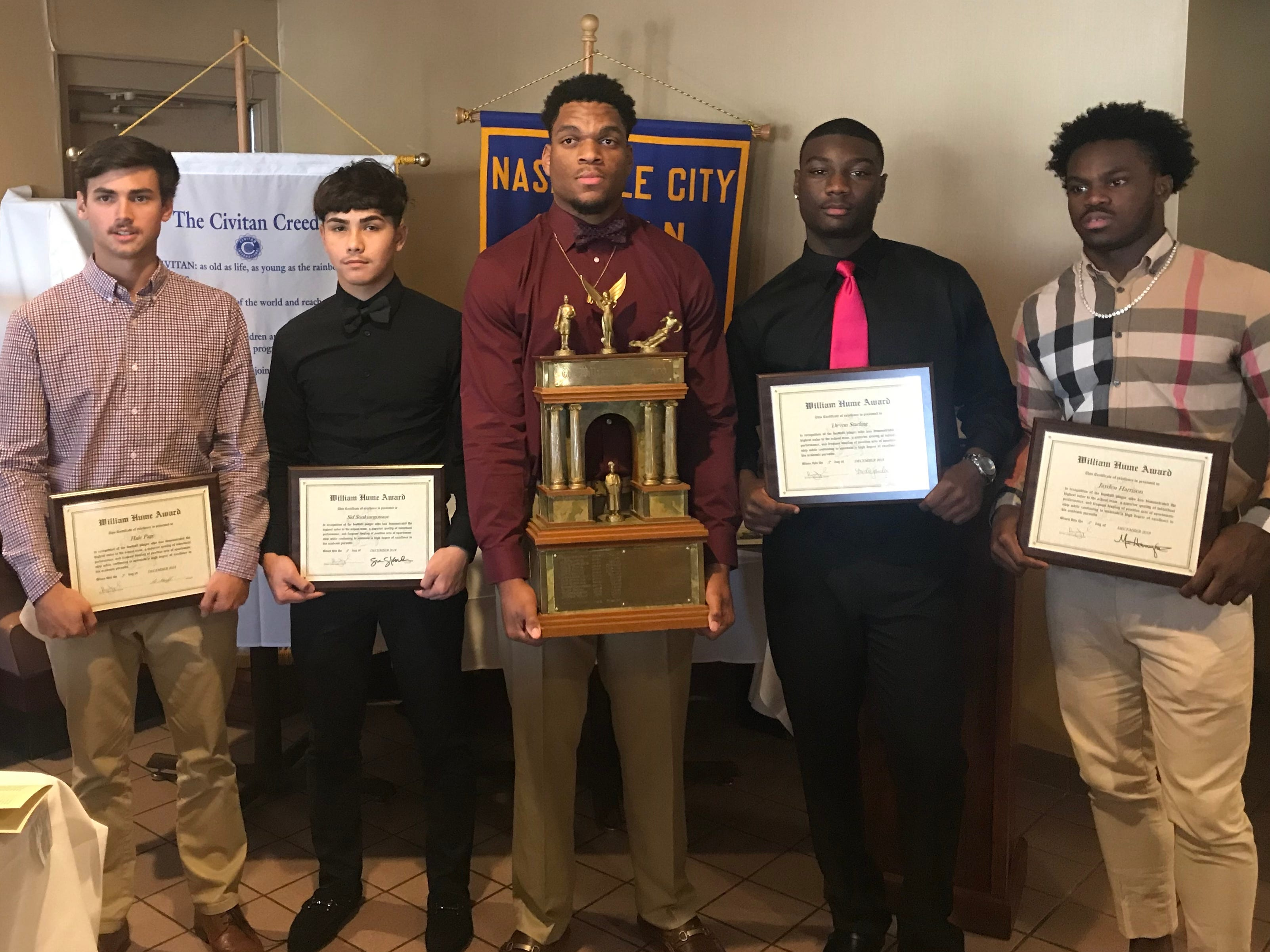 Hillsboro's Joe Honeysucker (center) won the 2018 Hume Award on Wednesday. Hillwoods Hale Page, Hunters Lane's Sid Souksangouane, Cane Ridge's Devon Starling and Pearl-Cohn's Jayden Harrison were named finalists for the 75th annual award.