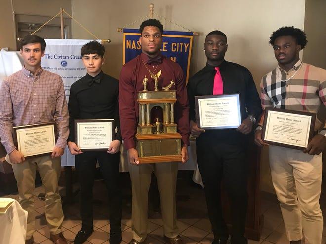 Hillsboro's Joe Honeysucker (center) won the 2018 Hume Award on Wednesday. Hillwoods Hale Page, Hunters Lane's Sid Souksangouane, Cane Ridge's Devon Starling and Pearl-Cohn's Jayden Harrison were named finalists for the 75th annual award.