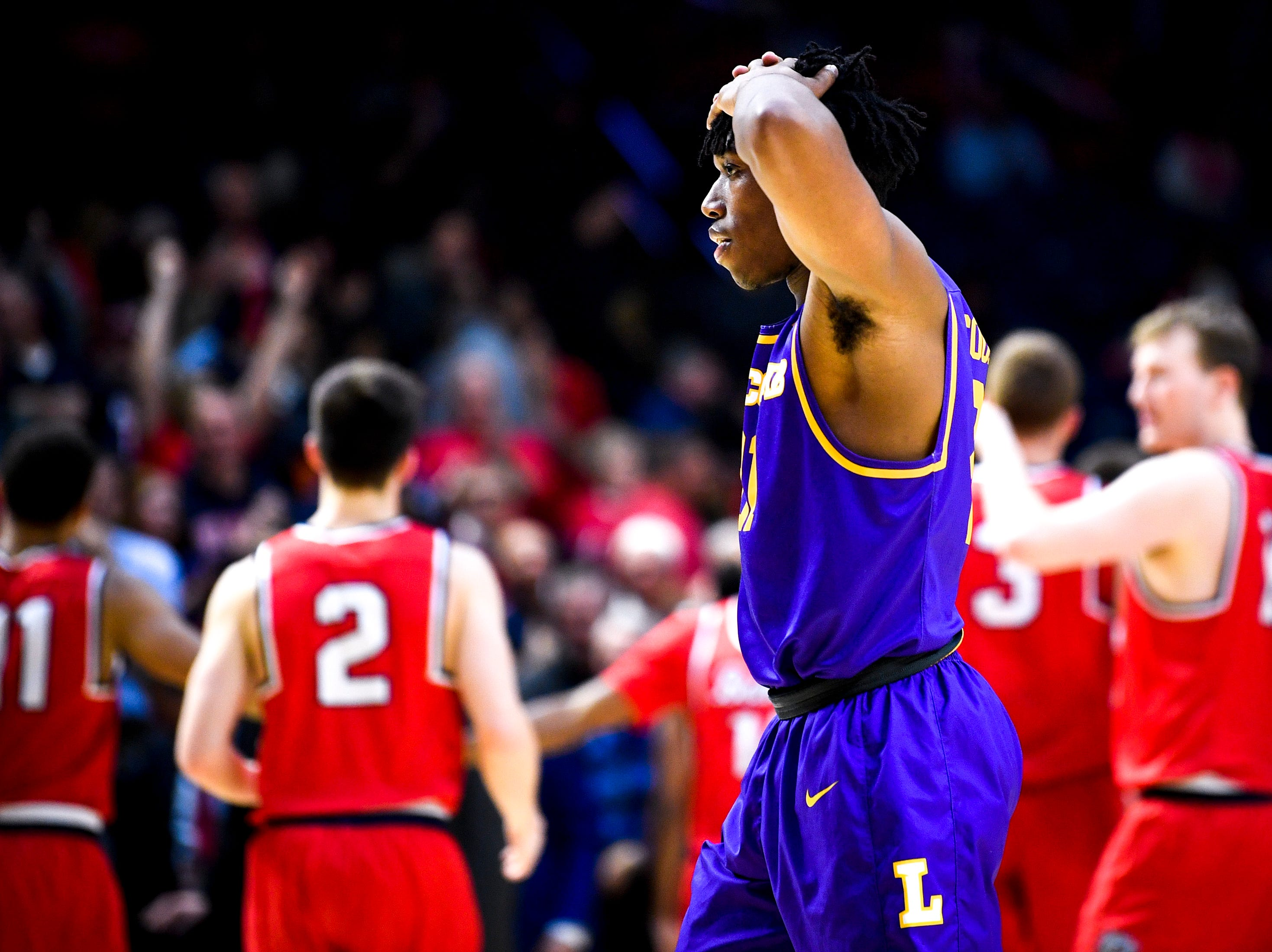 Lipscomb guard Kenny Cooper (21) reacts after Lipscomb's loss to Belmont at the Curb Event Center in Nashville, Tenn., Tuesday, Dec. 4, 2018.