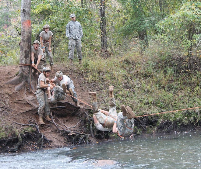 Fairview High JROTC cadets attempt to beat their best time in the rope bridge competition.
