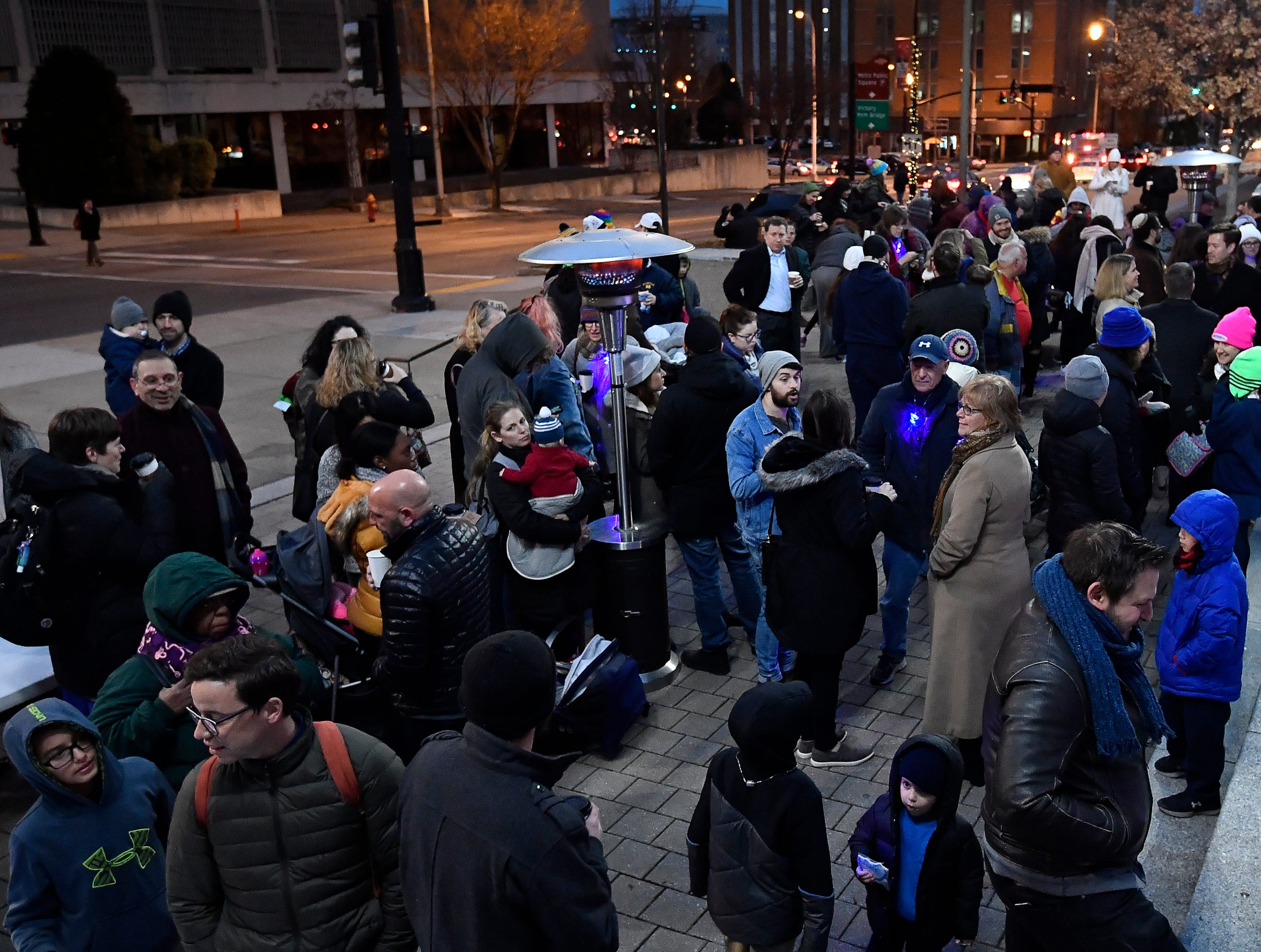 People gather on the steps of Public Square Park for a Chanukah menorah lighting ceremony Tuesday, Dec. 4, 2018, in Nashville, Tenn.