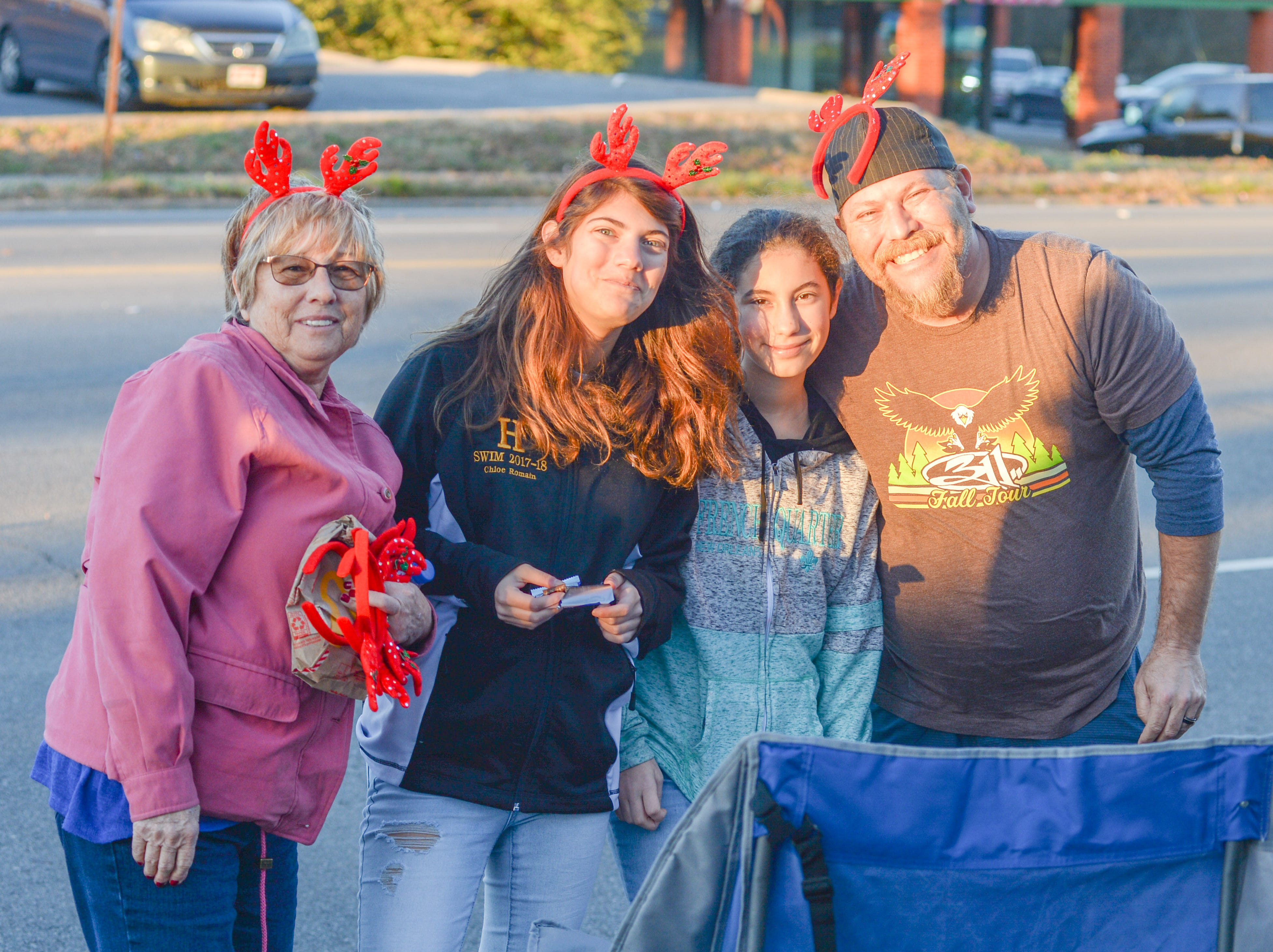Families enjoy the Hendersonville Christmas Parade on Sunday, Dec. 2.