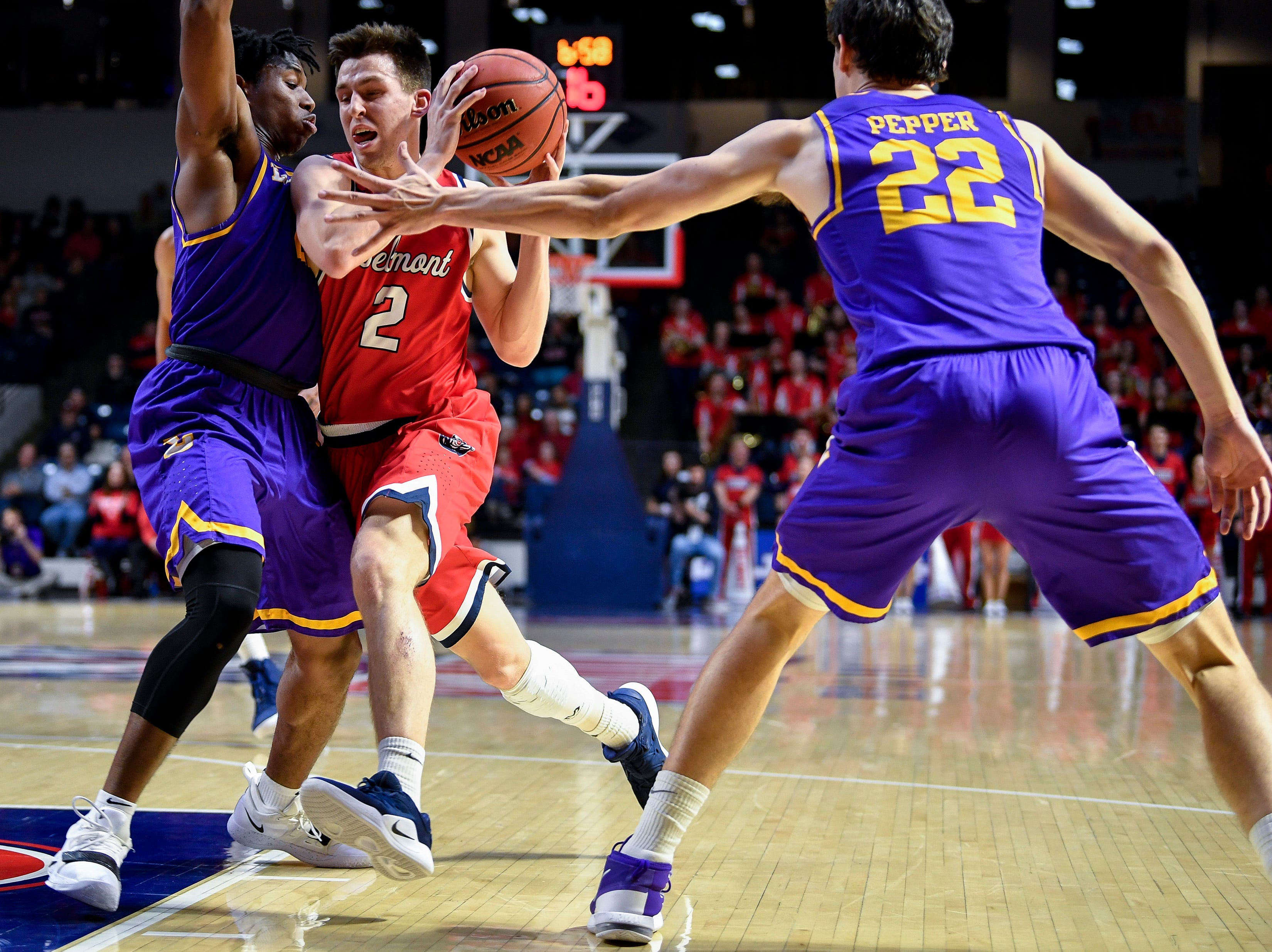 Belmont guard Grayson Murphy (2) advances against Lipscomb guard Kenny Cooper (21) and forward Eli Pepper (22) during the first half at the Curb Event Center in Nashville, Tenn., Tuesday, Dec. 4, 2018.