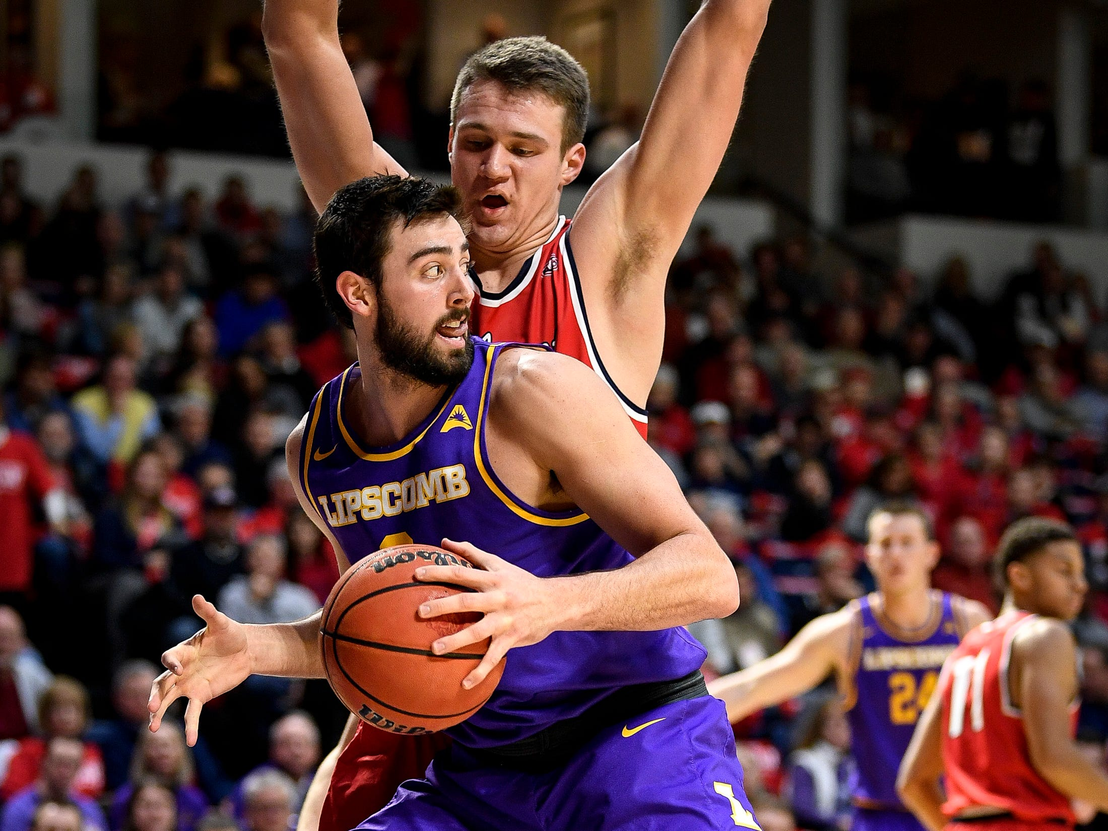 Belmont center Nick Muszynski (33) guards Lipscomb forward Rob Marberry (0) during the second half at the Curb Event Center in Nashville, Tenn., Tuesday, Dec. 4, 2018.