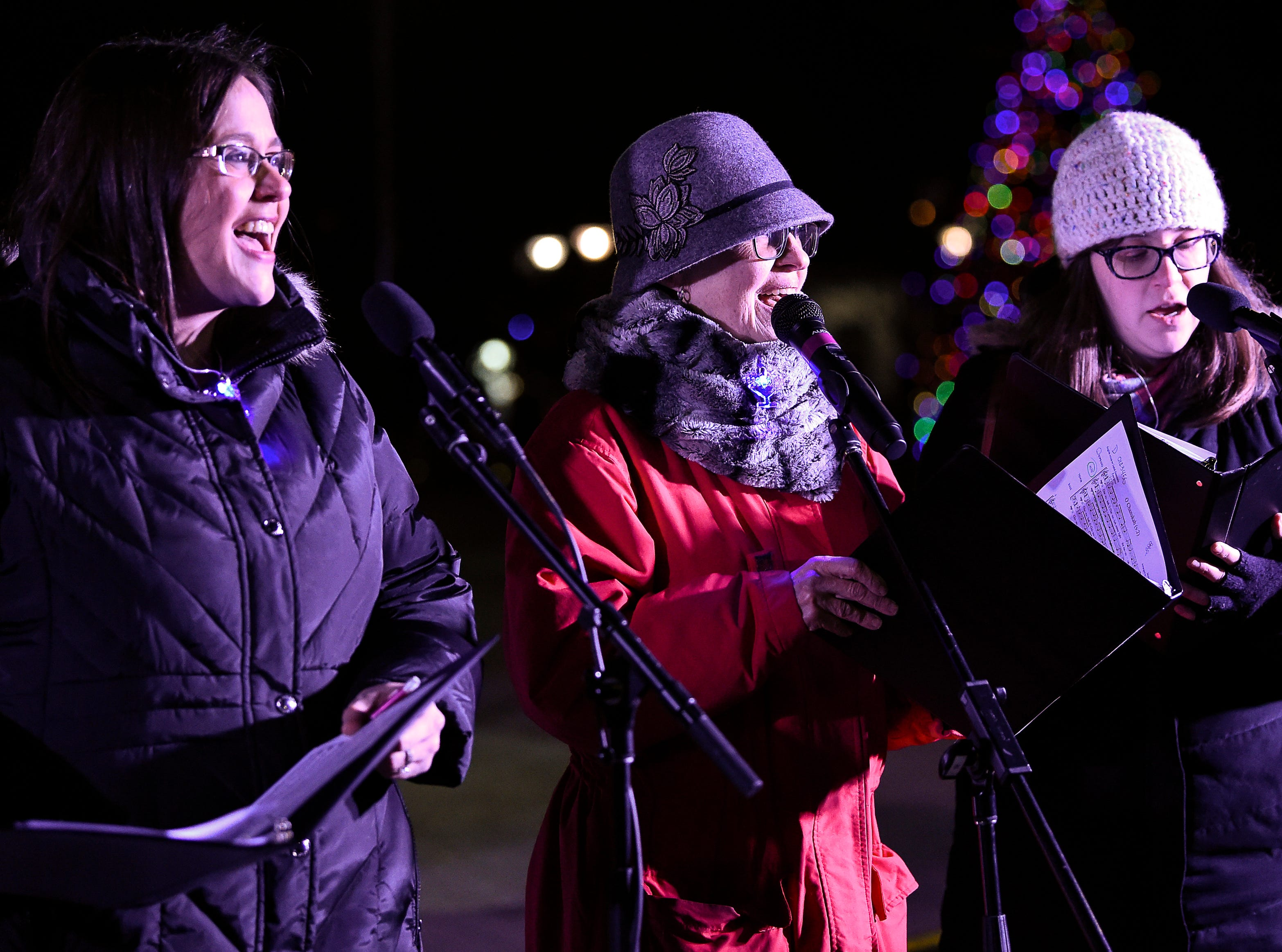 Performers sing Chanukah songs during a menorah lighting ceremony at Public Square Park Tuesday, Dec. 4, 2018, in Nashville, Tenn.
