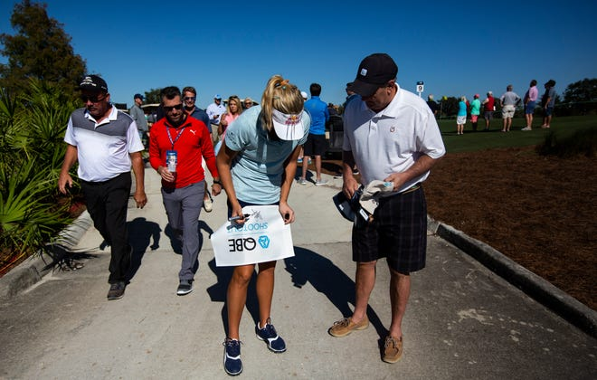 Florida native Lexi Thompson, signs an autograph after completing round one of the Professional - Amateur shootout during the 30th annual QBE Shootout at Tiburón Golf Club on Wednesday, Dec. 5, 2018.