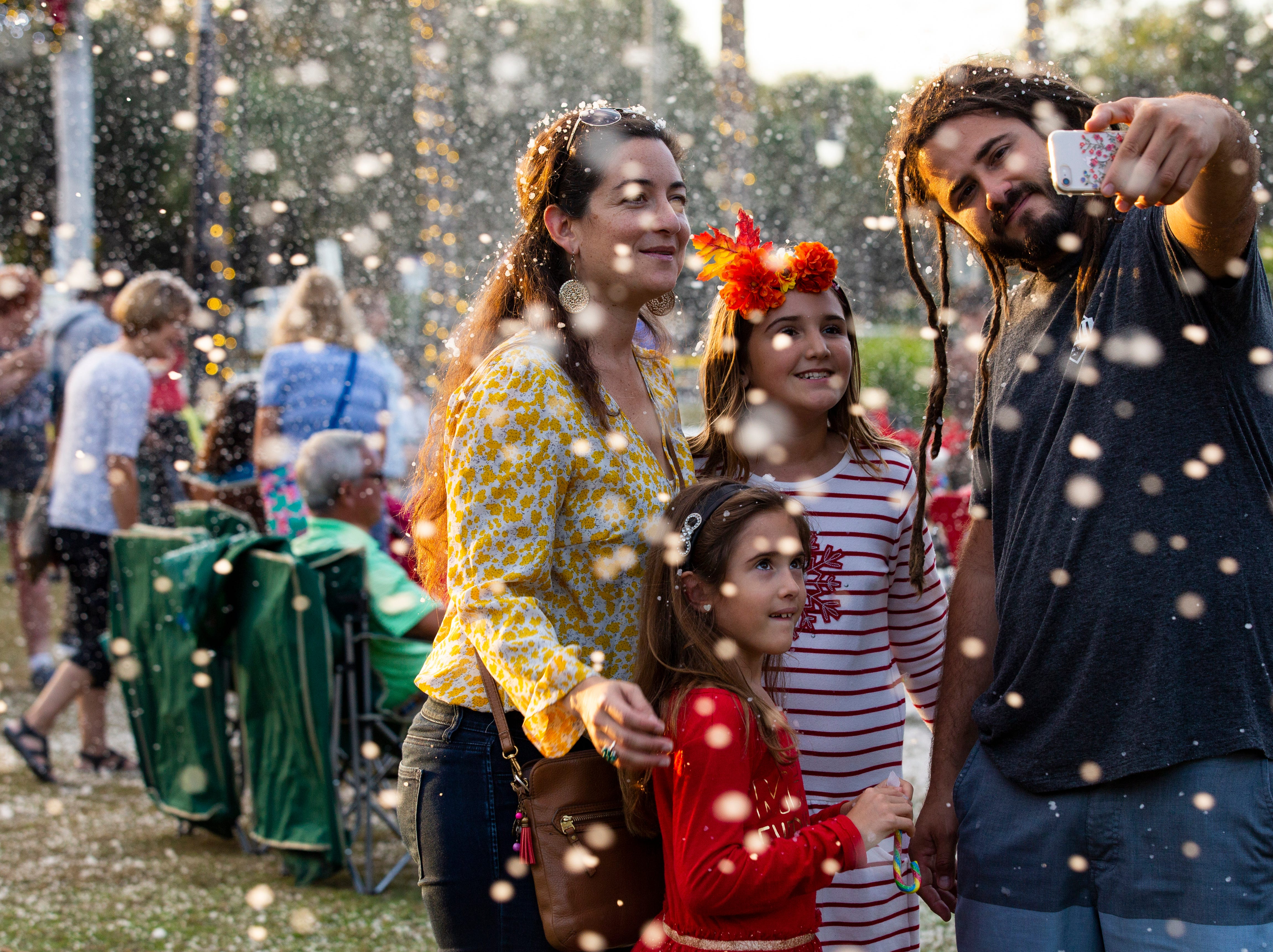 The Martinez family from Fort Myers poses for a selfie in the faux blizzard during the 19th annual Holiday in the Park on Dec. 4, 2018 at the Riverside Park in Bonita Springs.