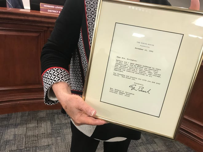 Estero Councilor Katy Errington holds a letter former president George H.W. Bush wrote to her after her son, a sergeant in the U.S. Air Force, died in 1992.