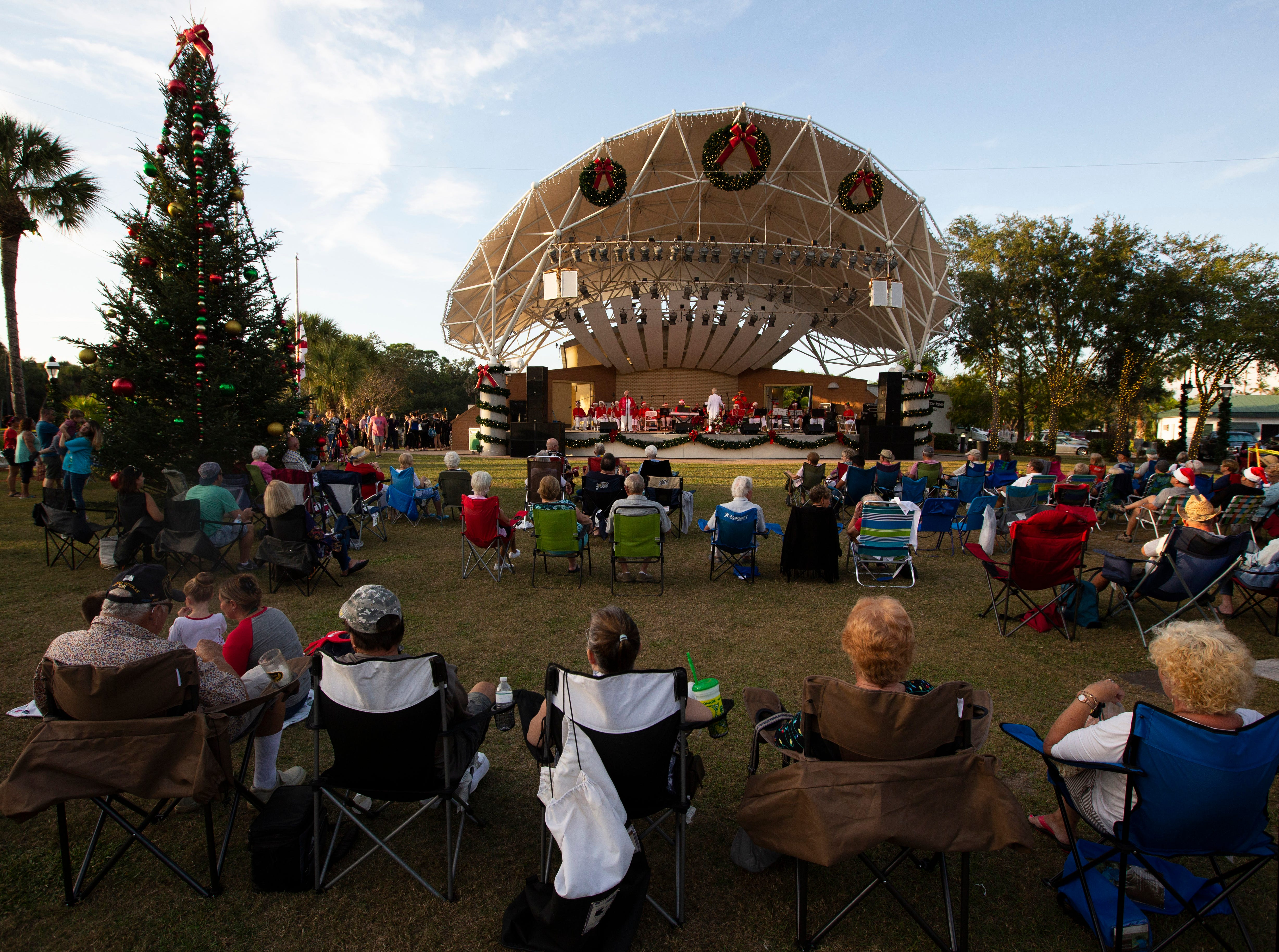 The 19th annual Holiday in the Park kicked off yesterday, Dec. 4, 2018 at the Riverside Park in Bonita Springs. While faux snow caused a foam blizzard families enjoyed live music, dance performances, taking photos with Mr. and Mrs. Claus, cookies, apple cider and the lighting of the Christmas Tree at dusk.