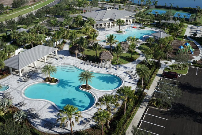 Two resort-style pools and a spa surrounded by palm trees and green spaces serve as the centerpiece of Orange Blossom's amenity offering.
