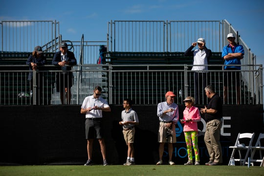 Spectators gather Wednesday morning, Dec. 5, 2018, at Hole 1, waiting for various Pro - Amateur pairings to tee off at the 30th annual QBE Shootout at Tiburón Golf Club.