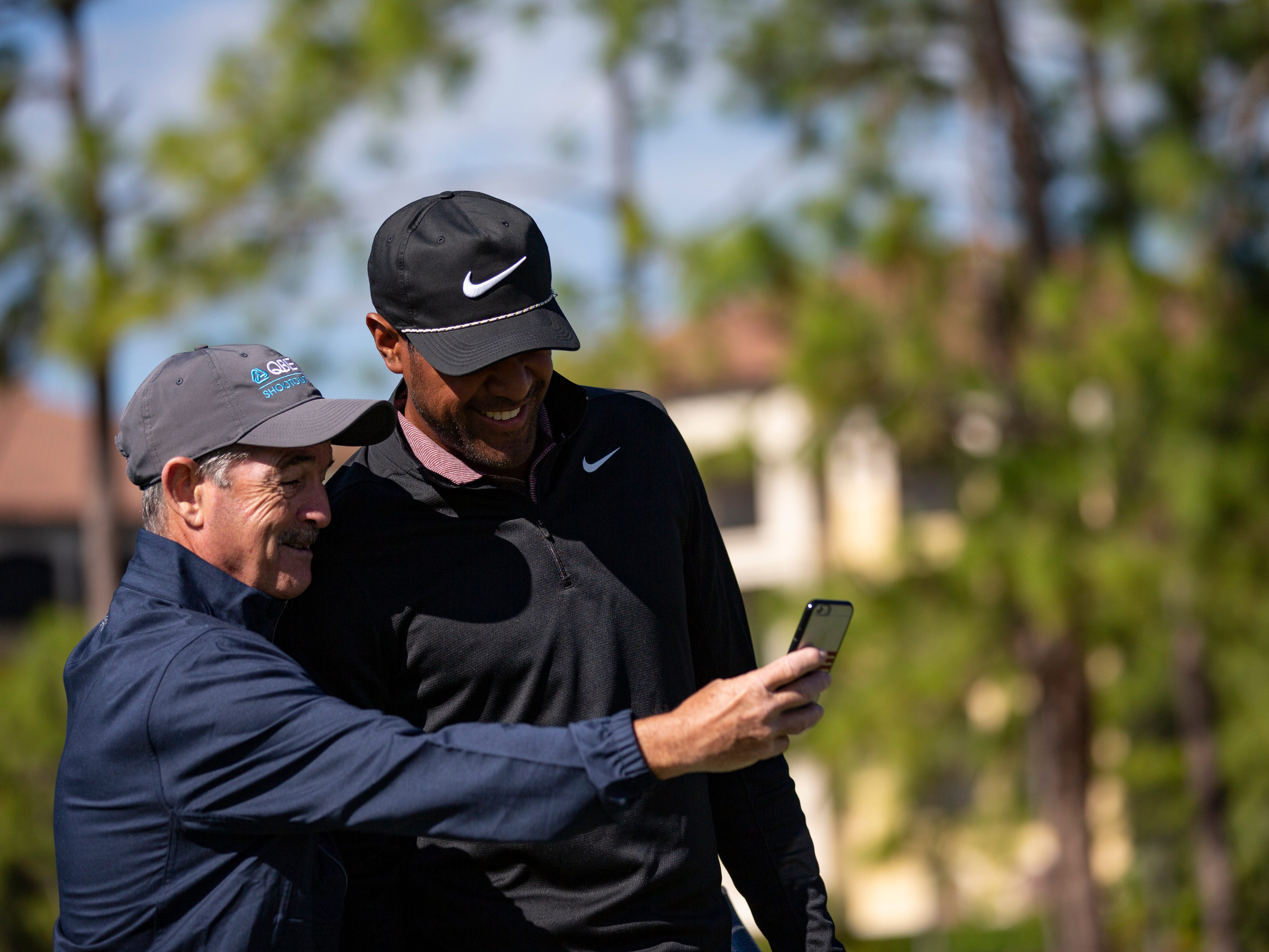 Before heading out to the next hole for the first Pro-Am round, pro golfer Tony Finau, right, stops to take a selfie with volunteer Jimmy Kelly on Wednesday, Dec. 5, 2018, at the 30th annual QBE Shootout at Tiburón Golf Club in North Naples.