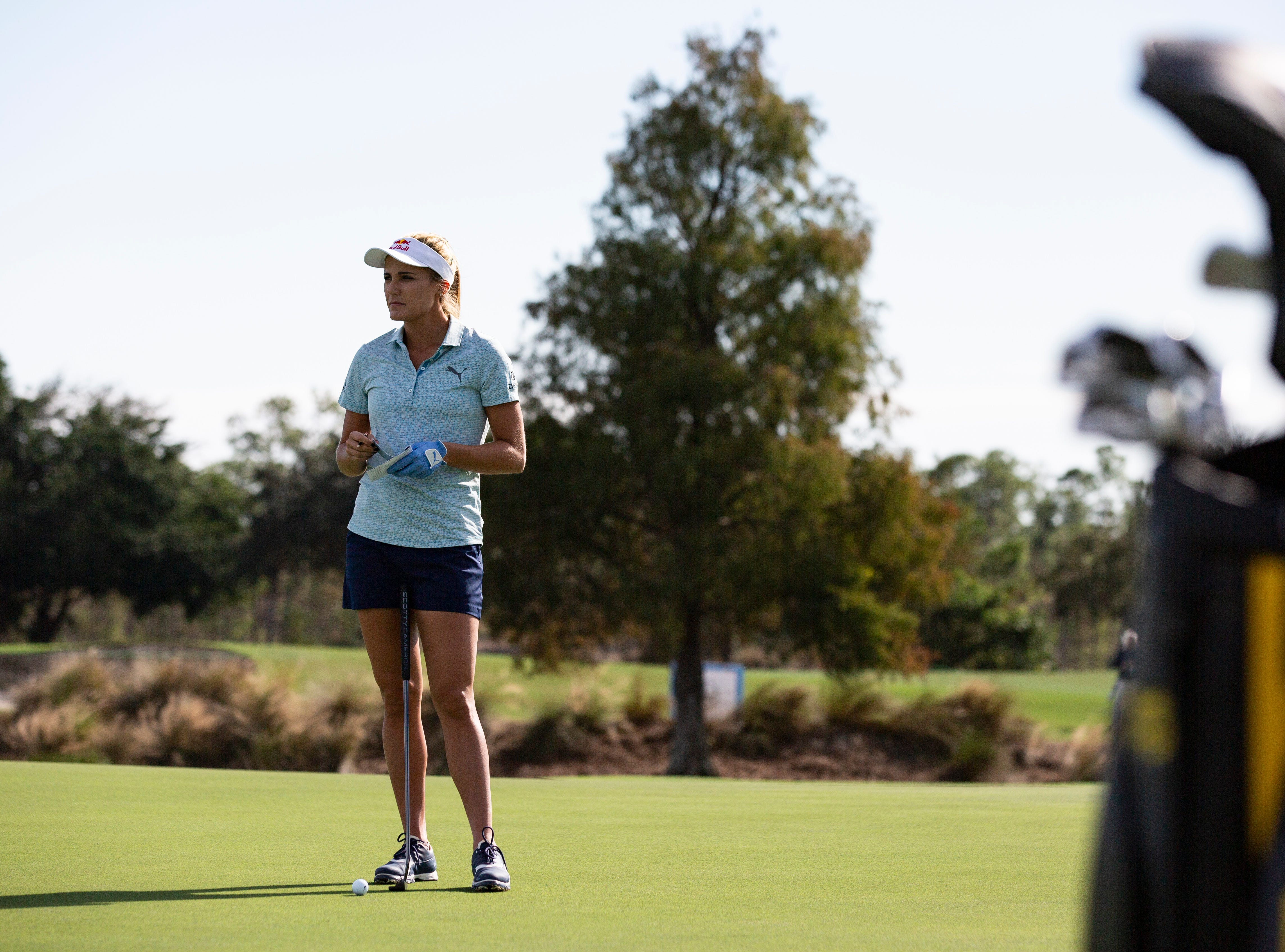 Lexi Thompson of Florida, contemplates her swing in reference to the yardage book  during the first Pro- Amateur round of the 30th annual QBE Shootout at Tiburón Golf Club on Wednesday, Dec. 5, 2018.