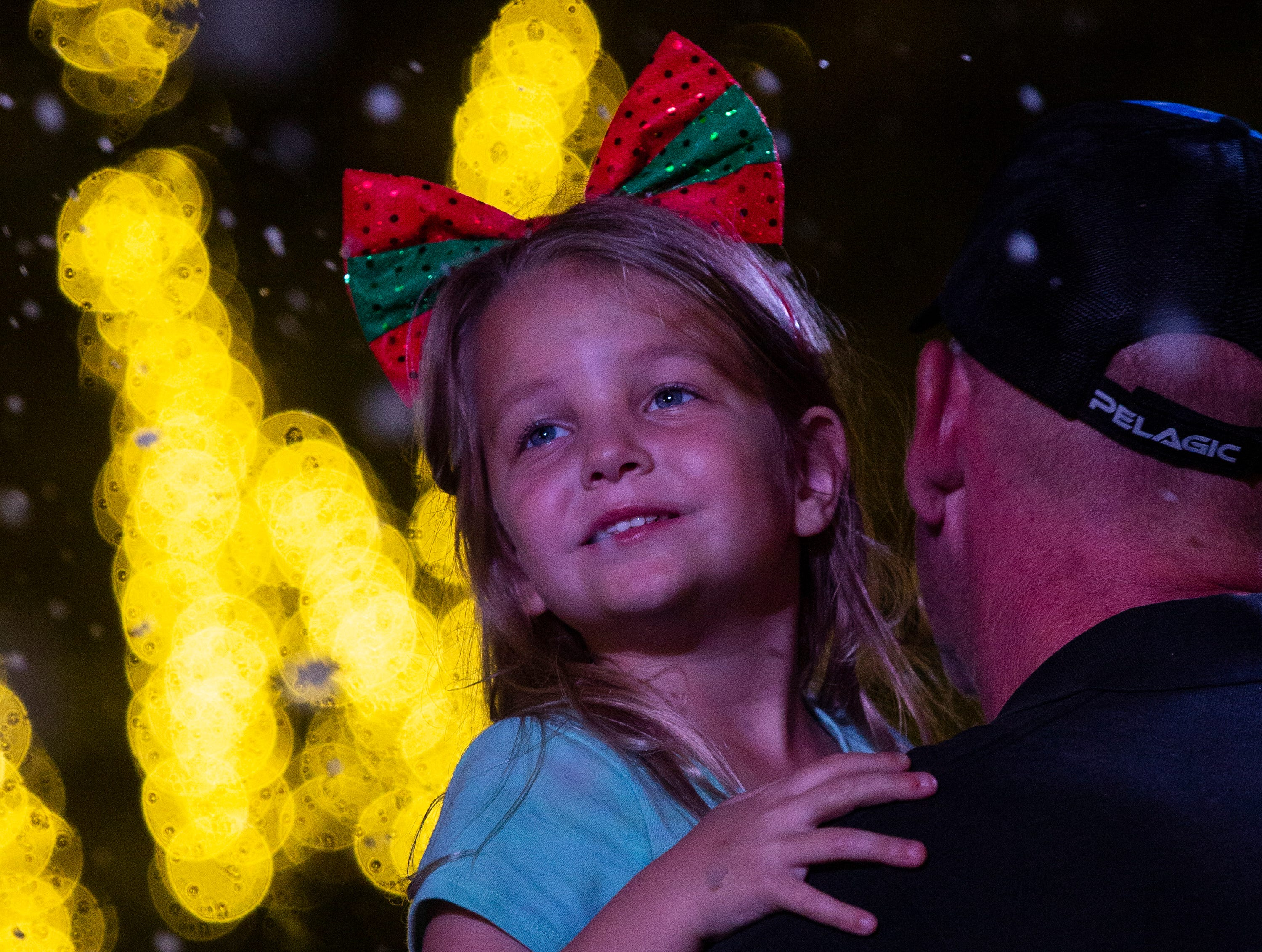 Four-year-old, Addison Goins, smiles as she watches the faux snow fill the air at  the 19th annual Holiday in the Park Christmas event on Dec. 4, 2018 at the Riverside Park in Bonita Springs.