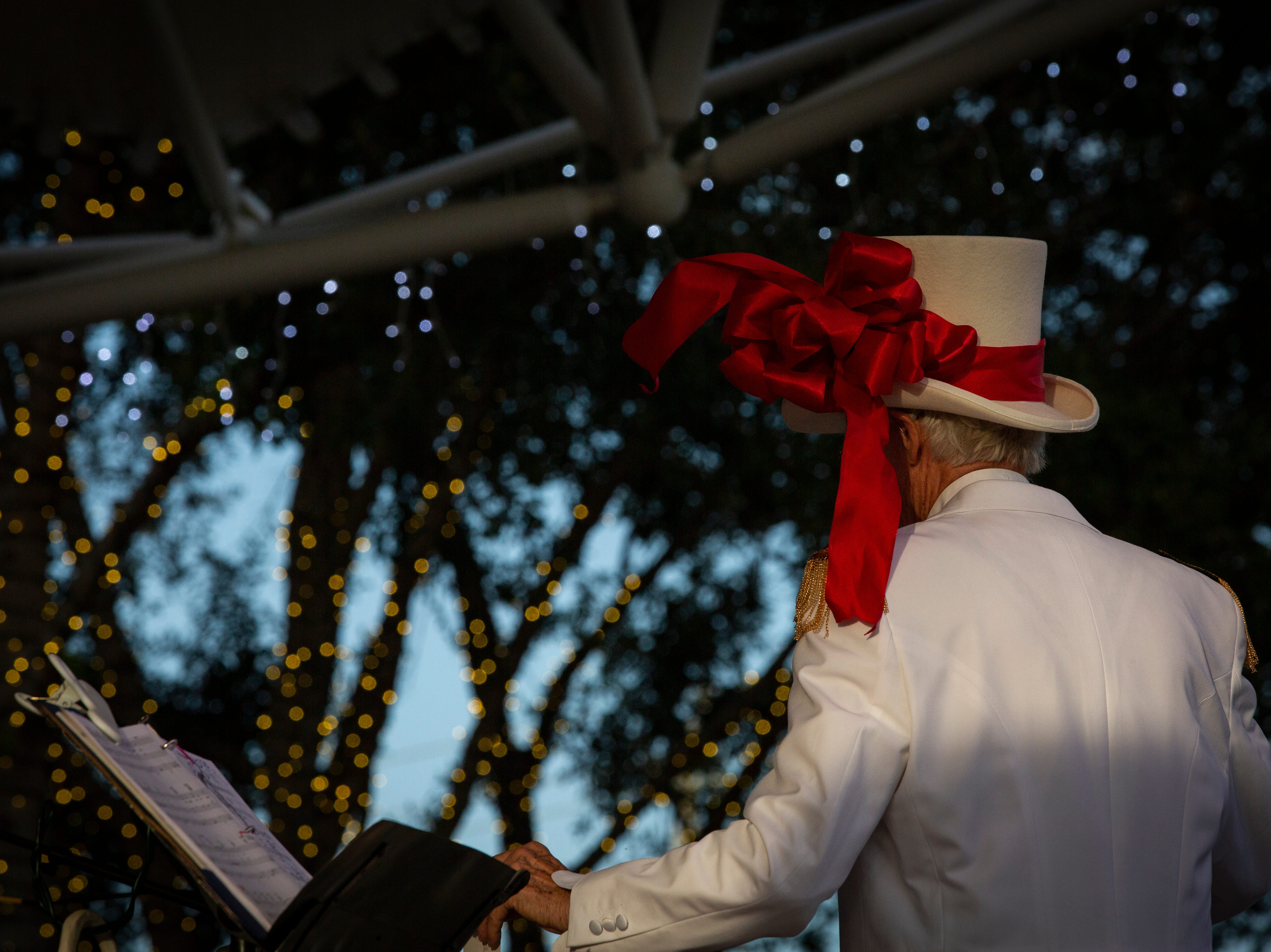 Doug Anderson leads the Bonita Village Band during the 19th annual Holiday in the Park event on Dec. 4, 2018 at the Riverside Park in Bonita Springs.