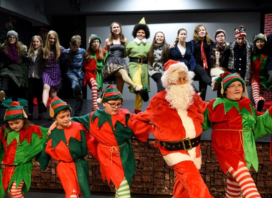 The entire cast of Hulabaloo Theater's production of Elf The Musical Jr practices their closing kick line during a rehearsal. The Christmas musical, based on the 2003 movie starring Will Ferrell, follows an over enthusiastic elf's journey from the North Pole to New York City. Show times are 7 p.m. Friday and Saturday December 7, 8, 14, and 15 and 2 p.m. Sunday December 9 and 16 at the Indian Mound Mall. Tickets are available at the door or at eventbrite.com for $6 for youth and $9 for adults.