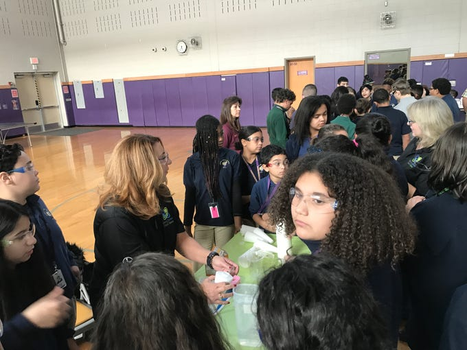 Students build rockets with the help a Robyn Rust, a Bayer volunteer and Garfield resident.