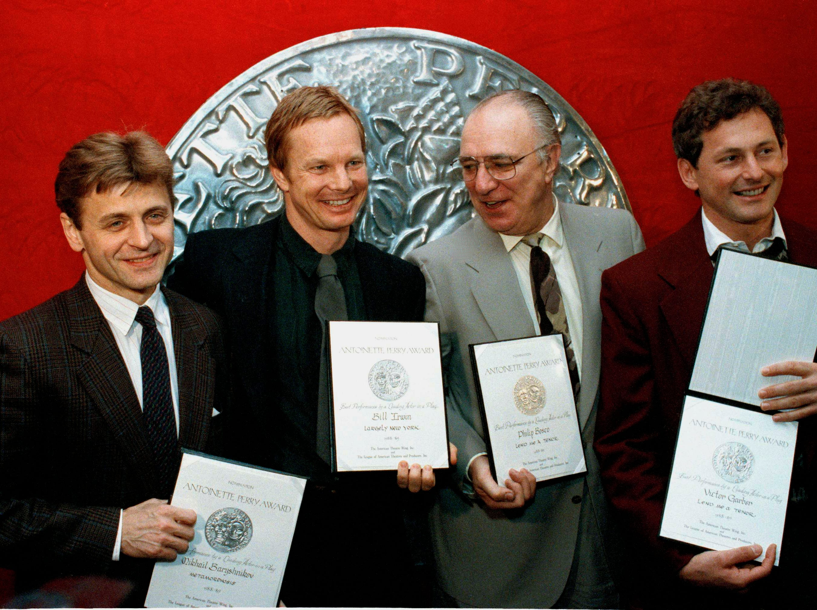 "Mikhail Baryshnikov, left, and three others nominated for the 1989 Tonys for best leading actor in a play, pose at a New York luncheon at Sardi's in New York, May 17, 1989, where formal nominations were handed out.  From left to right:  Baryshnikov, who was nominated for ""Metamorphosis""; Bill Irwin, for ""Largely New York""; and Philip Bosco and Victor Garber for ""Lend Me A Tenor.""  (AP Photo/Richard Drew)"