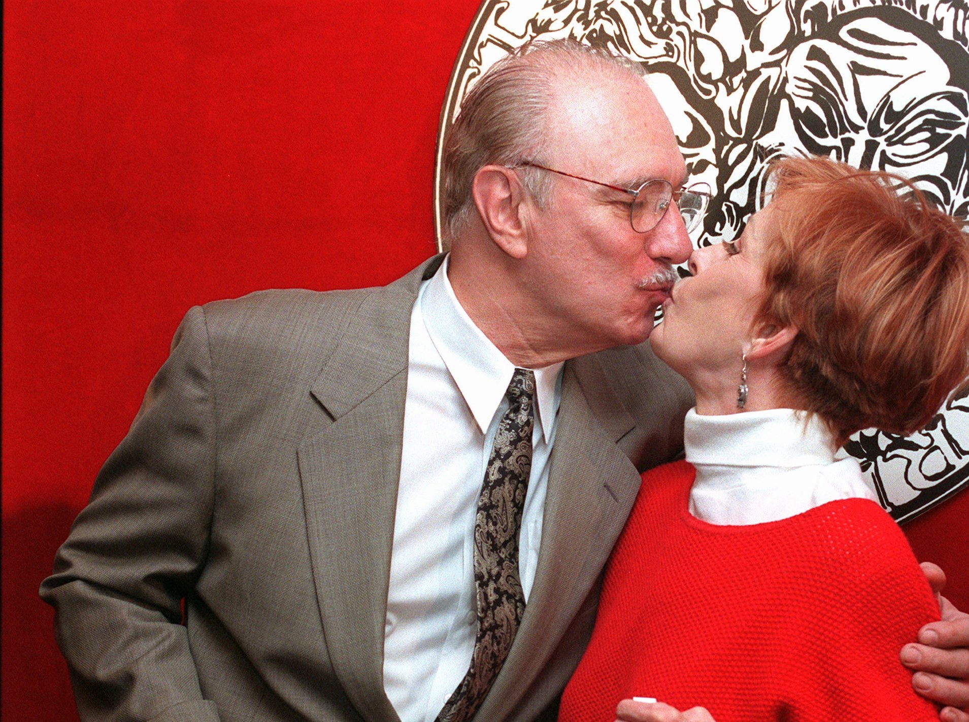 "Philip Bosco, left, and Carol Burnett pucker-up as they pose with their Tony Award nomination certificates during a photo session in New York, Wednesday, May 15, 1996.  The co-stars of Broadway's ""Moon Over Buffalo"" are nominated in the Best Performance by a Leading Actor and Actress in a Musical categories.  (AP Photo/Richard Drew)"
