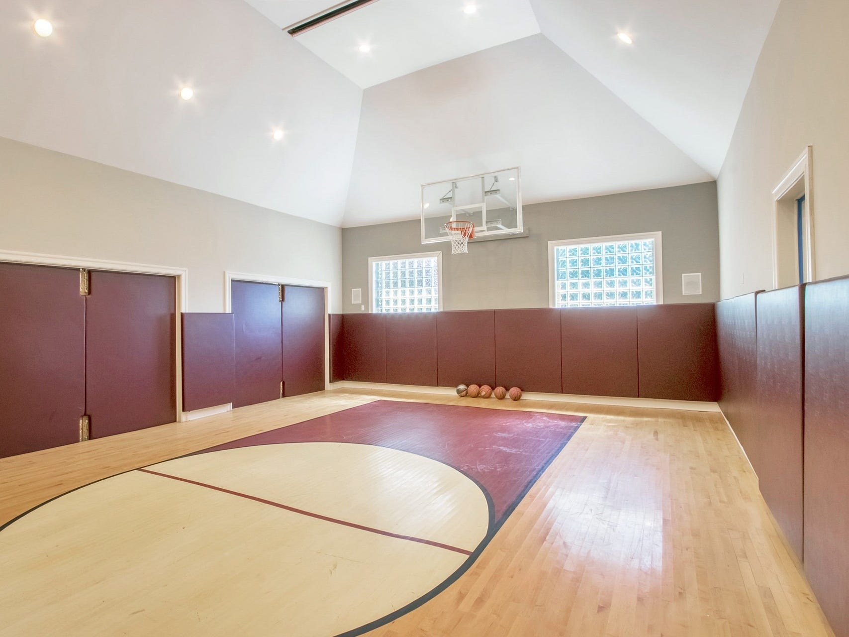 The basketball court also doubles as a gaming room with a drop-down video screen and surround sound.