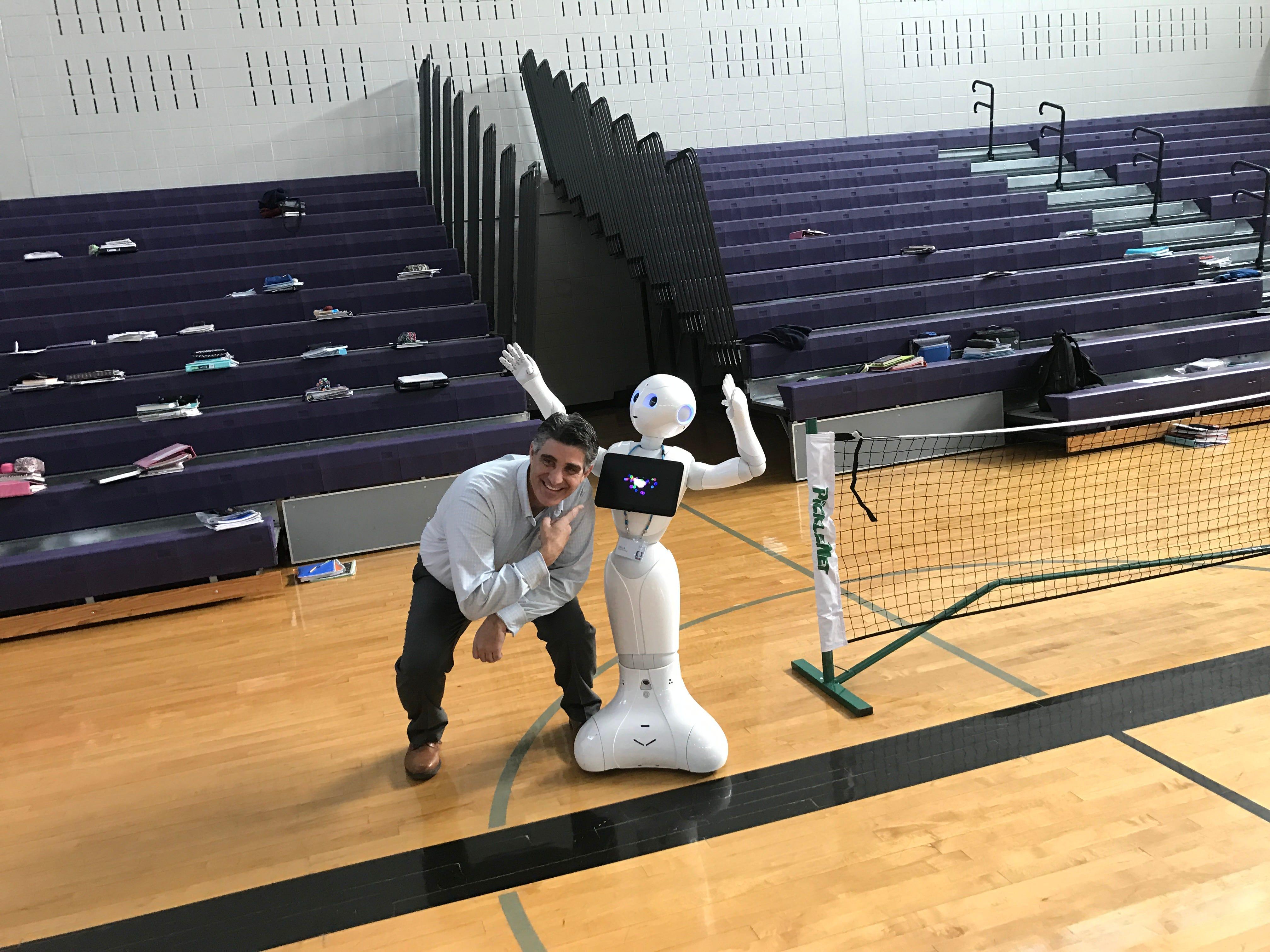 Garfield Middle School Principal Richard Rigoglioso with Bayer robot Bella