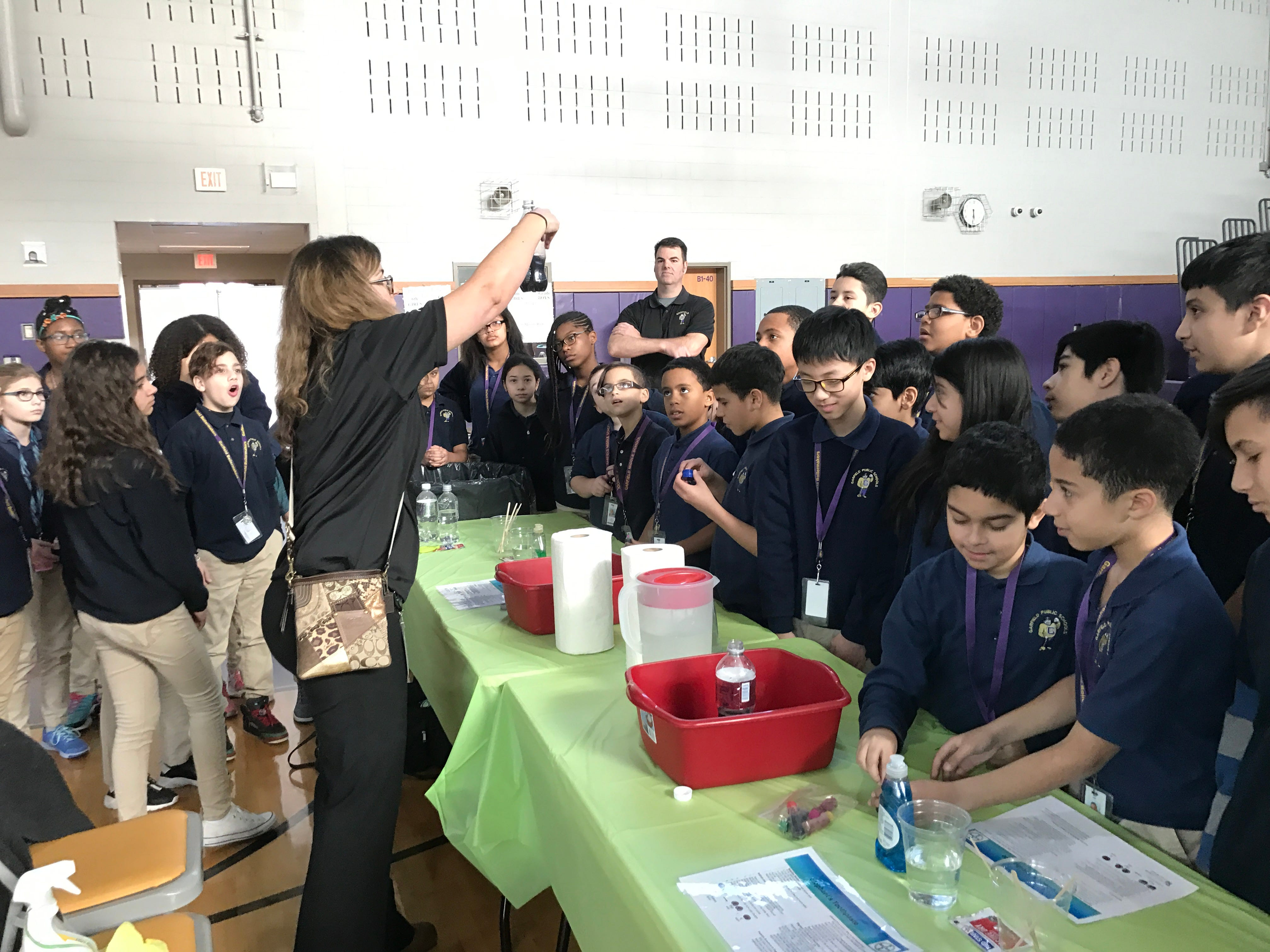 Students at Garfield Middle School learn about chemical reactions from a Bayer volunteer.