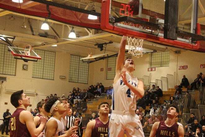 Patrick Cronin takes care of matters underneath the basket for Wayne Valley.
