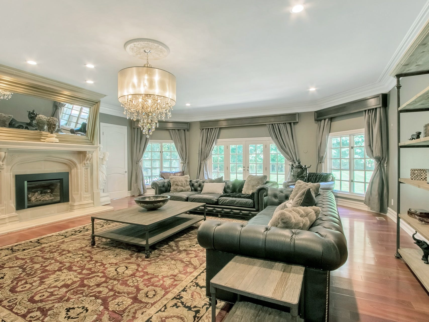 The sitting room, dining room and family room all feature Brazilian cherry wood floors and limestone fireplaces.