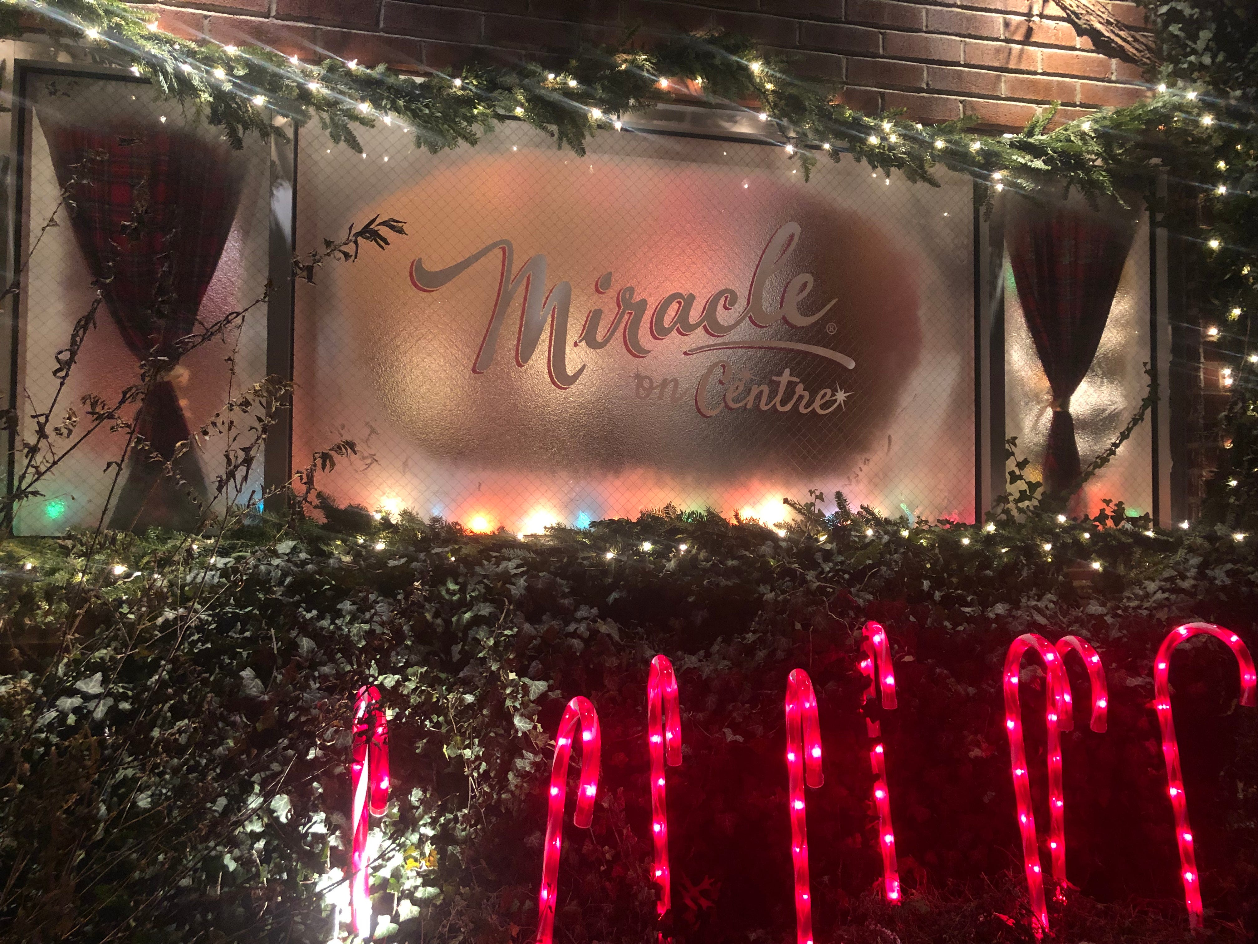 "A frosted window shows off the ""new"" name: Miracle on Centre."