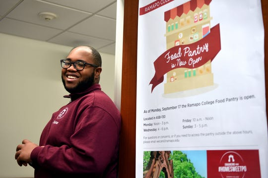 Ramapo College student government association president Stephan Lally and fellow student Jaime Velazquez, not pictured, are co-founders of the food pantry. Lally, shown at the entrance to the pantry on Monday, December 3, 2018, and Velazquez spearheaded the SGA initiative to form the pantry.