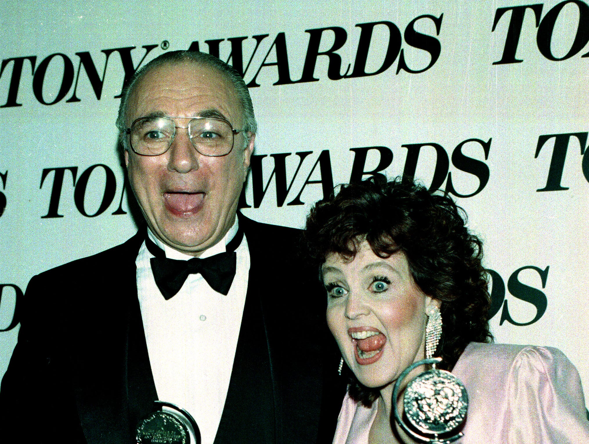 "Actor Philip Bosco, left, and actress Pauline Collins celebrate their Tony award win at the 43rd Annual Tony Awards ceremony in New York City, June 4, 1989.  Bosco won best actor in a play for ""Lend Me a Tenor"" and Valentine won leading actress in a play for ""Shirley Valentine."""
