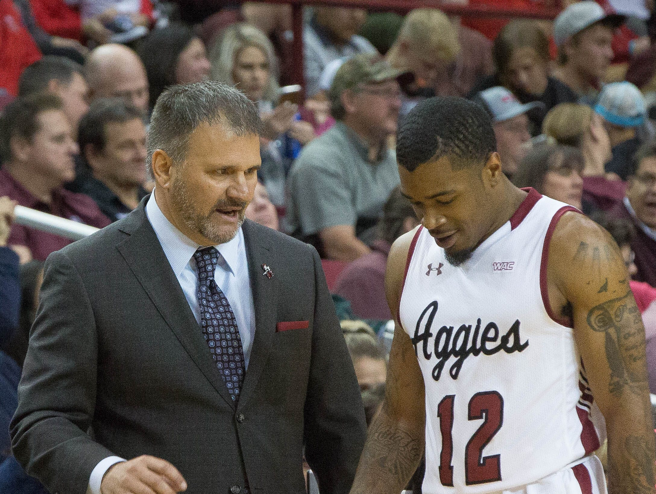 Chris Jans, headcoach at New Mexico State University talks with AJ Harris during the final minutes of the  NMSU, UNM game. NMSU  beat the University of New Mexico Tuesday December 4, 2018 at the Pan American Center, 100 to 65.
