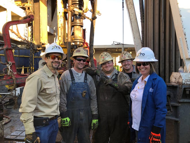 New Mexico State Land Commissioner Stephanie Garcia Richard meets with oil workers at an XTO site, Dec. 4, 2018 in Carlsbad.
