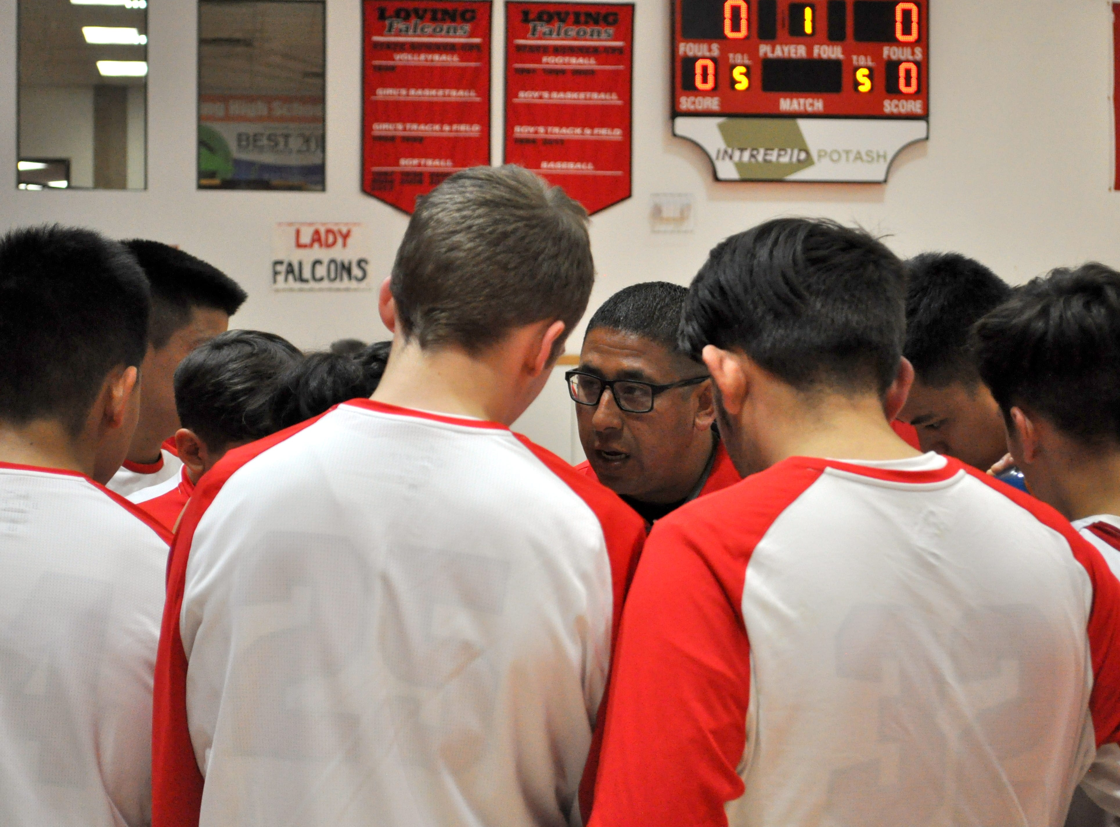 Bobby Parraz talks to his team before Tuesday's game against NMMI.