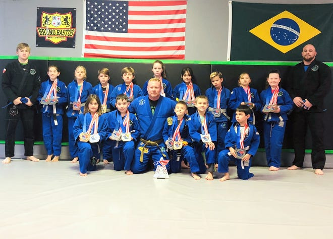 The Cavern City BJJ team poses after the Albuquerque BJJ Tournament. Cavern City BJJ took second place in the Kids No Gi Division with five gold medals, 13 silvers and two bronze medals for a total of 86 points.