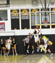 Lady Tiger Justyse Martin scores a field goal  at the Tularosa at Alamogordo girls basketball game Tuesday night.