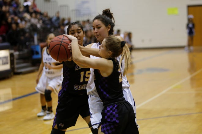 Kirtland Central's Peanut Dryden (2) snatches the ball away from Piedra Vista's Haley Weston Tuesday at Jerry A. Conner Fieldhouse in Farmington.