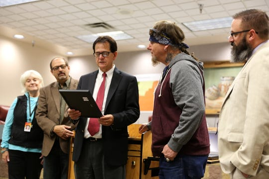 Members of the San Juan County Commission present Robert Shepherd, second from right and father of Chevel Shepherd, with a proclamation Tuesday declaring Chevel Shepherd Day in the county.