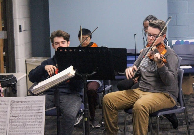 The first violin section rehearses Dec. 1.