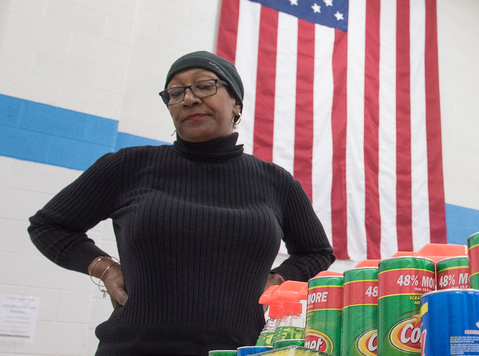 Volunteer Gail Monk takes a moment for a break before delivering more cleaning supplies to students packing for the veterans.