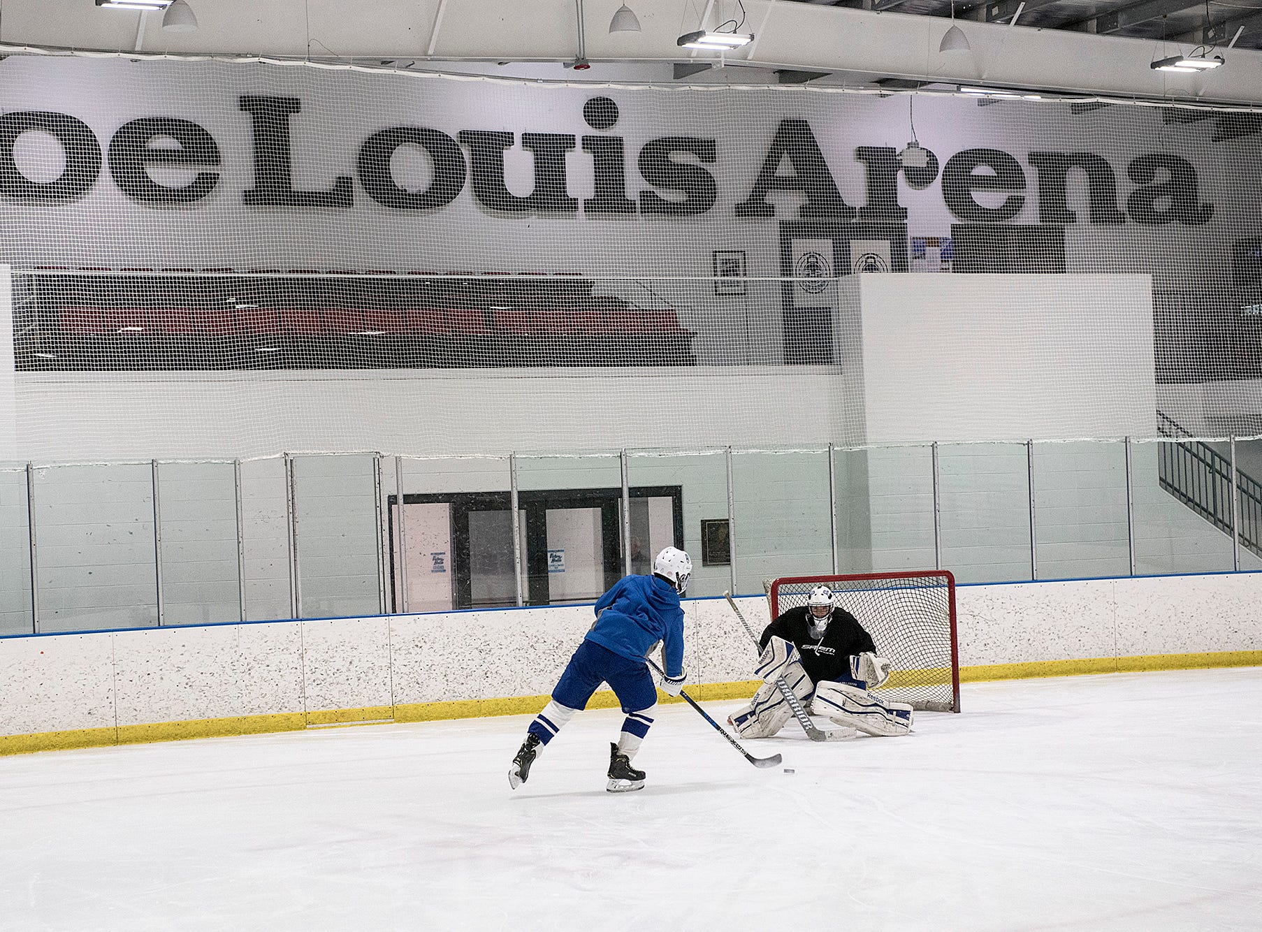 The new rink features a sign and seating from Joe Louis Arena.
